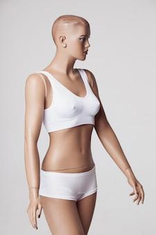The female mannequin on gray studio