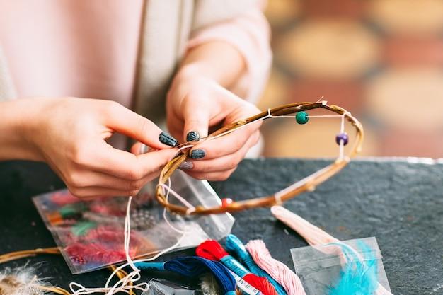 Female master creating new dreamcatcher