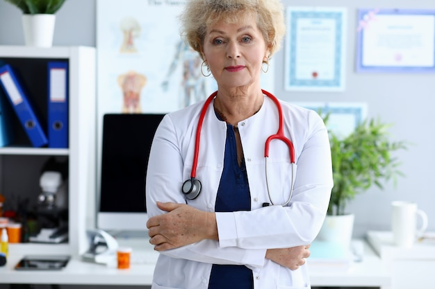 Female mature doctor against medical hospital
