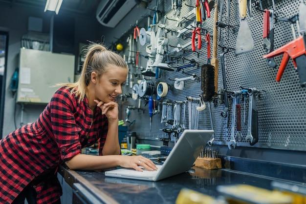 Female mechanic with laptop