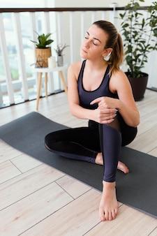 Female meditating indoor