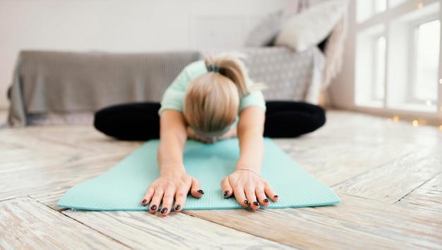 Female meditating on mat