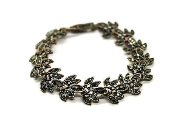 Female metallic bracelet isolated on white background