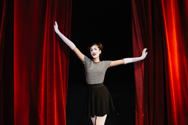 Female mime artist performing on stage