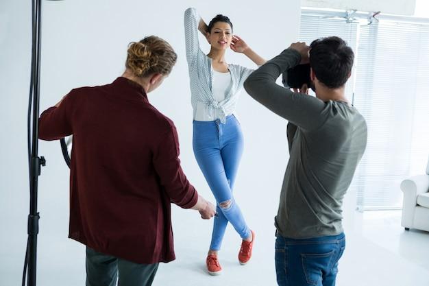 Female model posing for photographer