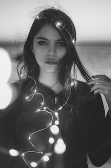 Female model posing with decorative light bulbs