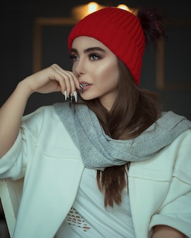 Female model in red beret and grey scarf