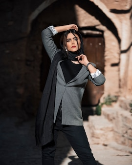 Female model wearing suit and hijab