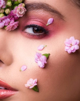 Female model with flowers in her face