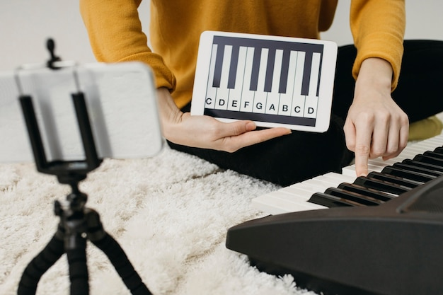 Female musician blogger streaming with smartphone at home