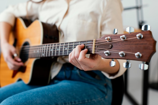 Female musician playing acoustic guitar