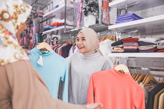 Female muslim best friend at fashion store