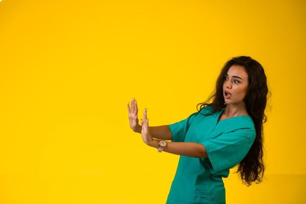 Female nurse trying to prevent danger.