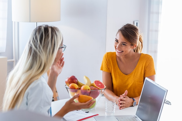 Female nutritionist giving consultation to patient