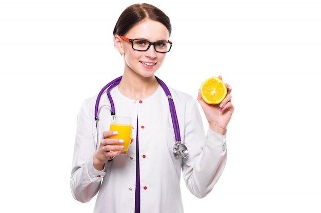 Female nutritionist hold orange in section and glass of fresh juice in her hands on white background