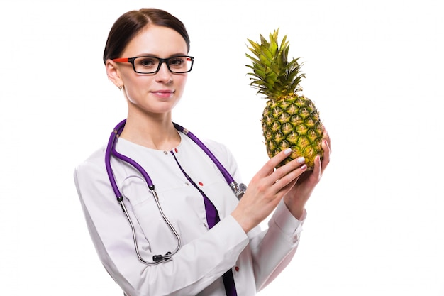 Female nutritionist hold pineapple in her hands on white