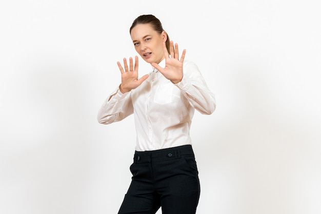 Female office employee in elegant white blouse on white