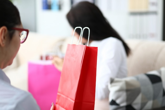 Female office worker looking at shopping bags