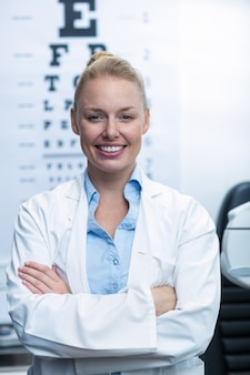 Female optometrist smiling in ophthalmology clinic