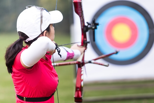 Female outdoors archer sunny competition