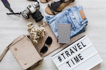 Female outfits and accessories with travel and time text