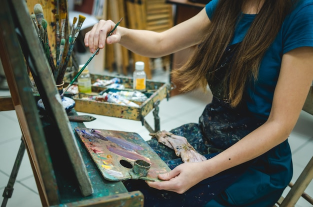 Female painter drawing in art studio