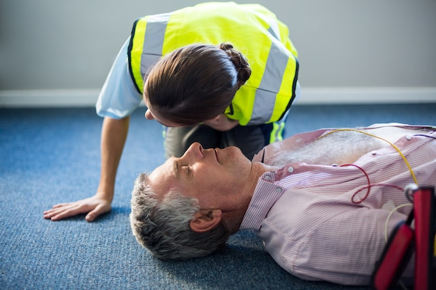 Female paramedic during cardiopulmonary resuscitation training