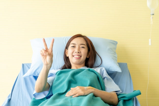 Female patient on hospital bed