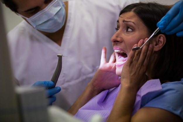 Female patient scared during a dental check-up