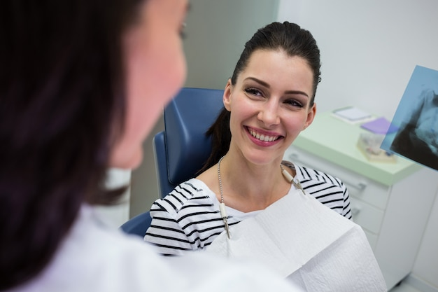 Female patient smiling while talking to doctor