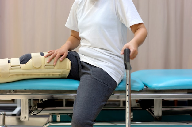 Female patient wearing knee support