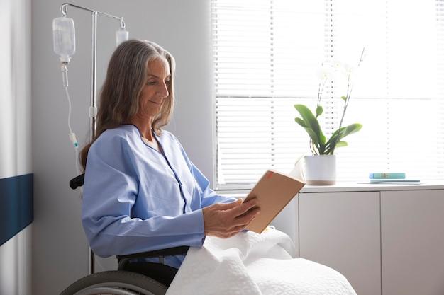 Female patient in wheelchair indoors