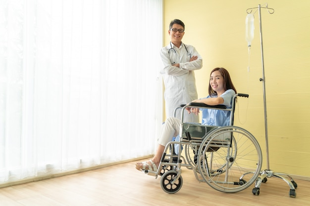 Female patient on wheelchair with senior doctor