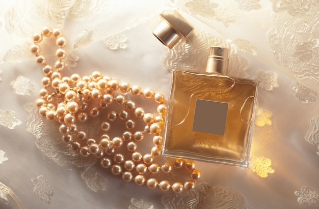 Female perfume with pearls