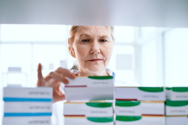 Female pharmacist choosing the right medical product