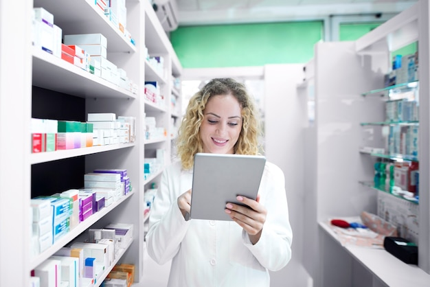 Female pharmacist working in drug store