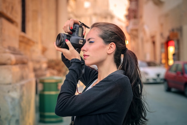 Female photographer taking a picture