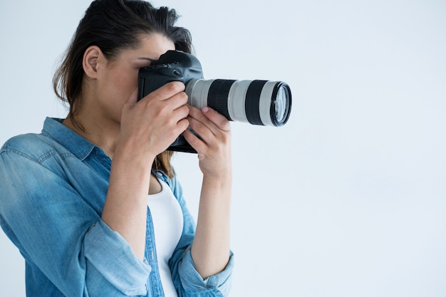Female photographer with digital camera