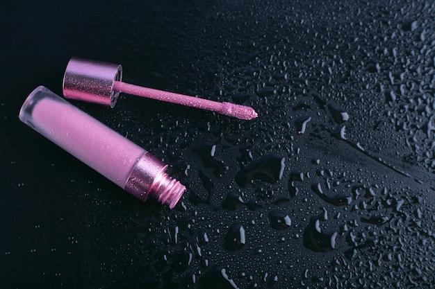 Female pink lipstick on dark background