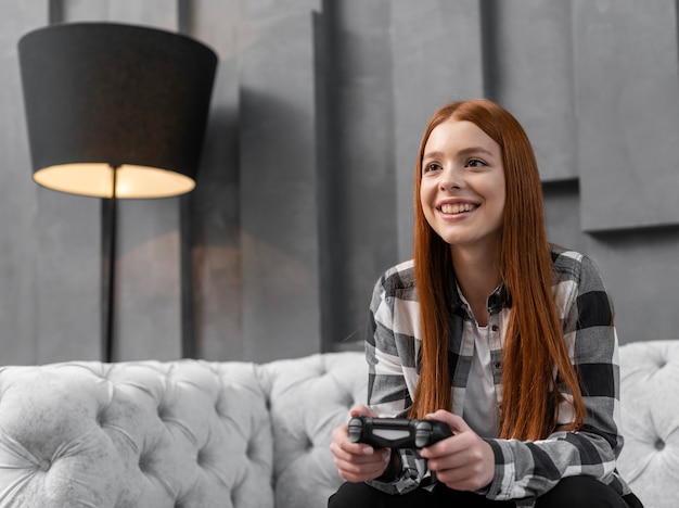 Female playing video games indoors