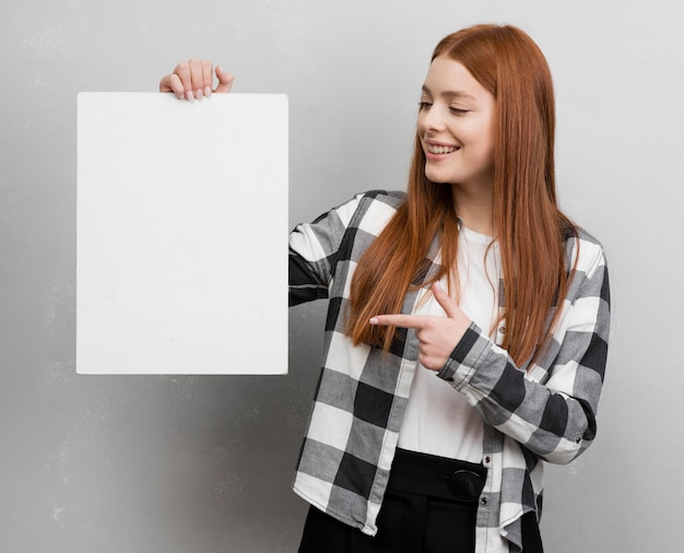 Female pointing at blank card