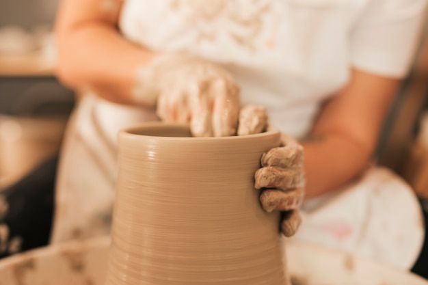 Female potter working on pottery wheel