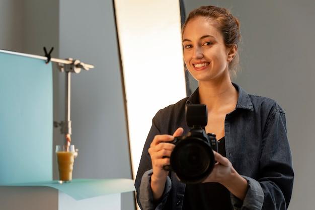 Female product photographer in studio