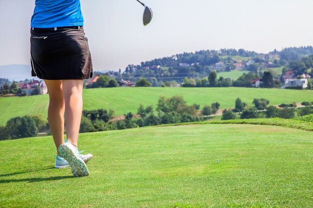Female professional golfer playing at the golf course of zlati gric in slovenia