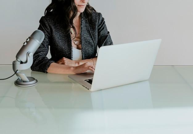 Female radio host is broadcasting online in a studio