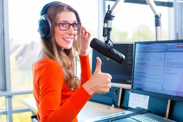 Female radio presenter in radio station on air