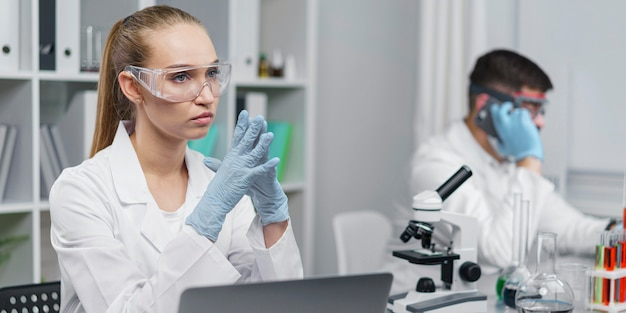 Female researcher in the laboratory with safety glasses
