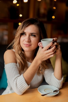 Female at restaurant drinking coffee