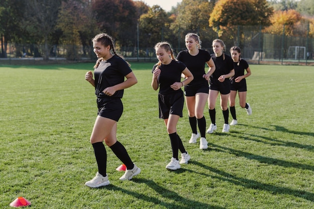 Female rugby team running through cones