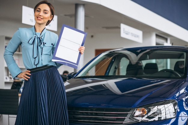 Female salesperson at a car showroom